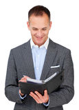 Attractive businessman consulting his agenda Stock Photography