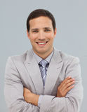 Attractive businessman with folded arms Stock Photo
