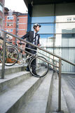 Attractive businessman with  his bike Royalty Free Stock Photography