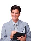 Attractive businessman holding an agenda Stock Photo