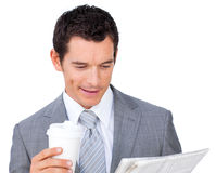Attractive businessman holding a drinking cup Royalty Free Stock Images