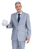 Attractive businessman holding gift Royalty Free Stock Image