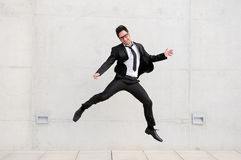 Attractive businessman jumping in the street Royalty Free Stock Images