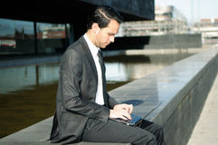 Attractive businessman with a laptop computer Stock Photo