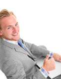 Attractive businessman with laptop sitting down Royalty Free Stock Image