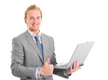 Attractive businessman with laptop sitting down Royalty Free Stock Photos