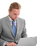 Attractive businessman with laptop sitting down Royalty Free Stock Photography