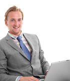 Attractive businessman with laptop sitting down Stock Photo