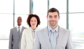 Attractive businessman leading his colleagues Royalty Free Stock Photo