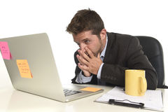 Attractive businessman looking worried in stress at office laptop computer having work problem Royalty Free Stock Image