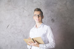 Attractive businessman with notepad Stock Images