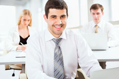 Attractive businessman in an office Royalty Free Stock Photography