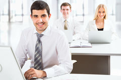 Attractive businessman in an office Stock Image