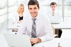 Attractive businessman in an office Royalty Free Stock Photo