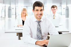 Attractive businessman in an office Royalty Free Stock Image