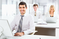 Attractive businessman in an office Royalty Free Stock Photos