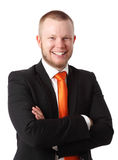 Attractive businessman in orange tie Stock Photography