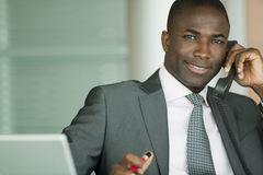 Attractive businessman on the phone Royalty Free Stock Image