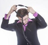 Businessman adjusts tie Stock Images