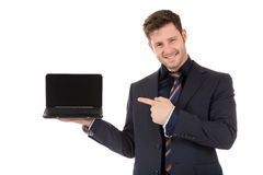 Attractive businessman pointing, laptop Stock Photo