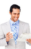 Attractive businessman reading a newspaper Stock Photo