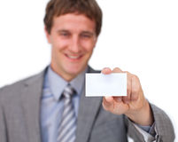 Attractive Businessman showing a business card Stock Photos