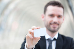 Attractive businessman showing an empty textspace card Royalty Free Stock Photography