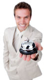 Attractive businessman showing a service bell. Isolated on a white background Royalty Free Stock Image