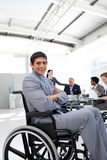 Attractive businessman sitting in a wheelchair Stock Photos
