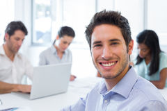 Attractive businessman smiling in the workplace Stock Images