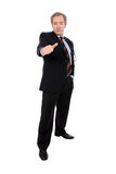 Attractive businessman standing with thumb up Royalty Free Stock Image