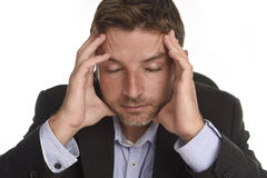 Attractive businessman suffering work stress and headache holdin Stock Photo