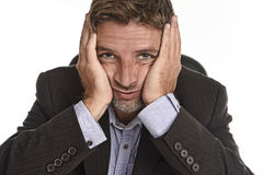 Attractive businessman in suit looking tired and exhausted suffering stress and headache Royalty Free Stock Photo
