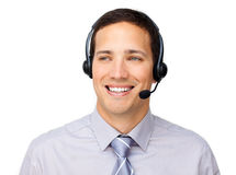 Attractive businessman talking on headset. Against a white background Royalty Free Stock Image