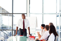 Attractive businessman talking in a meeting Stock Photography