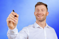 Attractive businessman or teacher with marker royalty free stock image