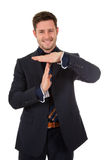 Attractive businessman time out symbol Stock Images