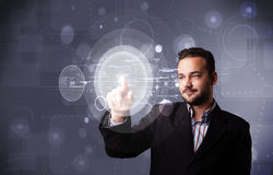 Attractive businessman touching abstract high technology circula Royalty Free Stock Photo