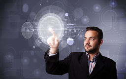 Attractive businessman touching abstract high technology circula Royalty Free Stock Photography