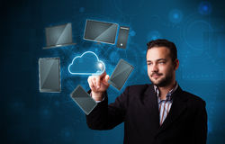 Attractive businessman touching high technlogy cloud service Royalty Free Stock Photography