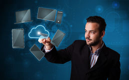 Attractive businessman touching high technlogy cloud service Royalty Free Stock Images