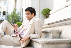 Businessman using cell phone. Royalty Free Stock Images