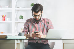Attractive businessman using mobile phone Royalty Free Stock Photography