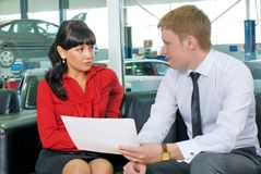 Attractive businesspeople in car shop Stock Photo