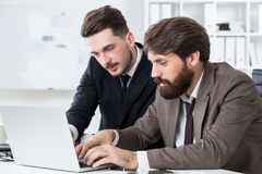 Attractive businesspeople discussing project Stock Image