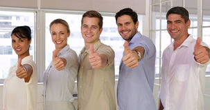 Attractive businesspeople posing showing thumbs up stock video