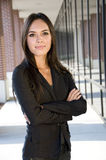Attractive businesswoman. With smirk in front of an office building Royalty Free Stock Photo