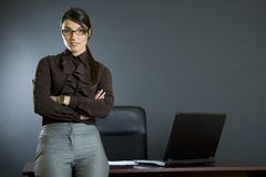 Attractive businesswoman against office desk royalty free stock photo