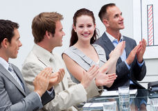 Attractive businesswoman applauding in a meeting Royalty Free Stock Photo