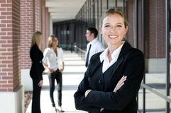 Attractive businesswoman with arms crossed Stock Photo